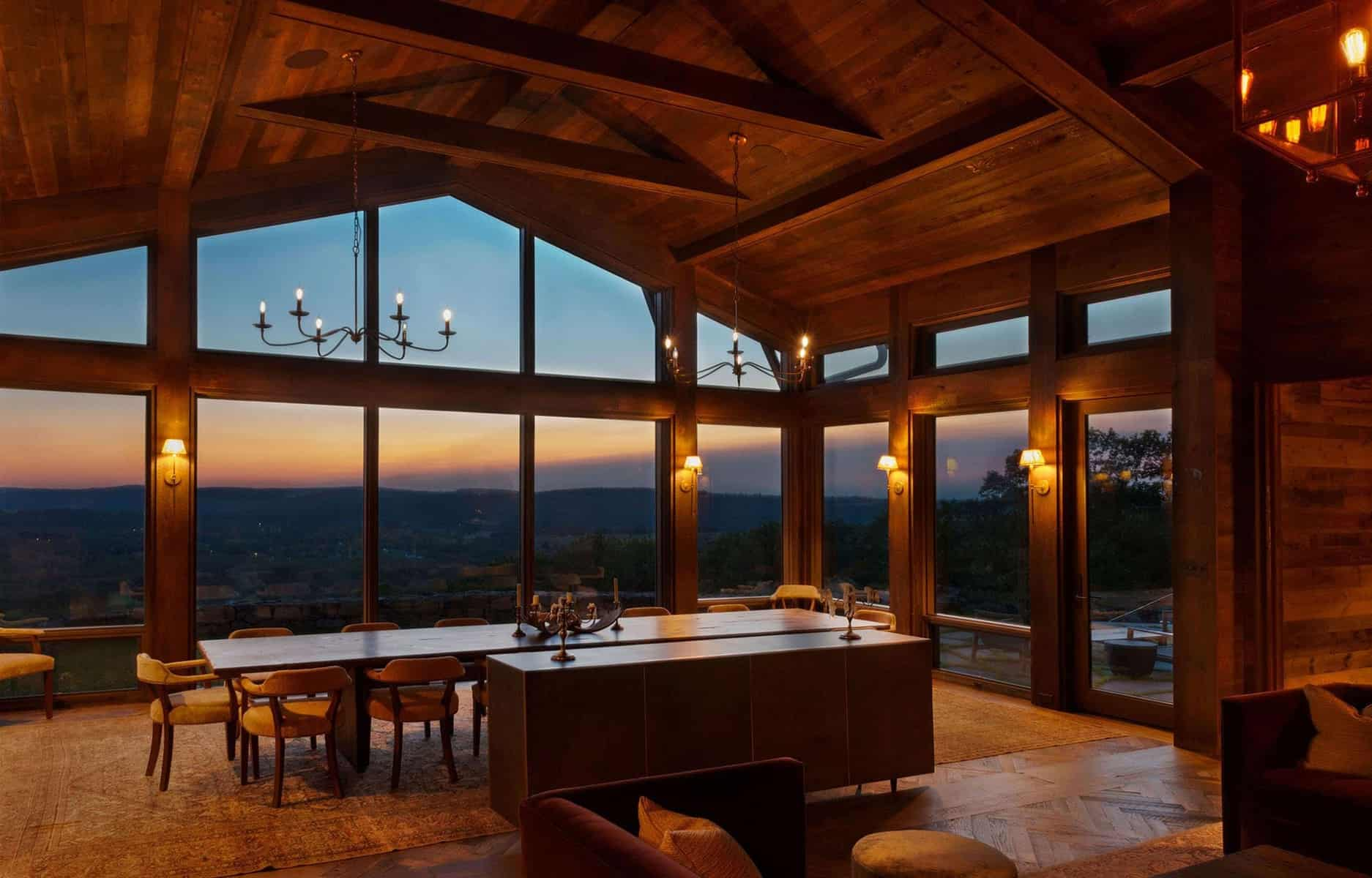 Taconic Lodge dining room at night by UCE Fine Builders