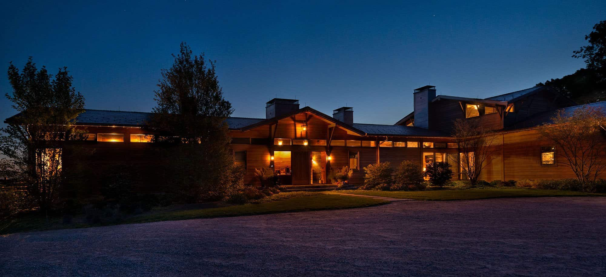 Taconic Lodge front entrance at night by UCE Fine Builders